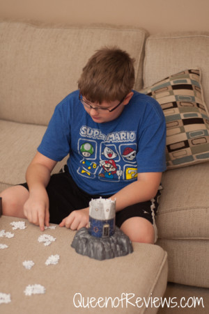 Ethan assembling Lighthouse at Night 3D Puzzle from Ravensburger
