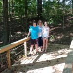 Justine Phoebe and Ethan on bridge at Shuckles