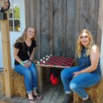 Hannah and Madison playing checkers at Shuckles