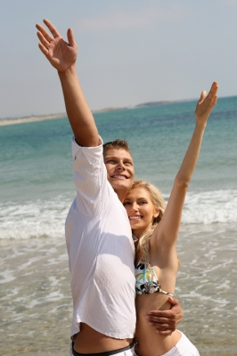 Young Couple Enjoying At Beach